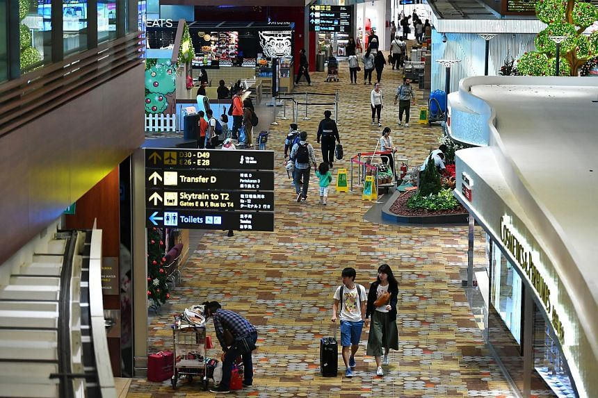 File photo showing passengers in the transit area of Changi Airport Terminal One on Dec 26, 2017.