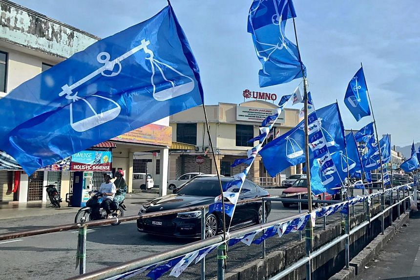 Barisan Nasional and 1 Malaysia flags seen along the road near the Balik Pulau Umno building in Simpang Empat, Balik Pulau.