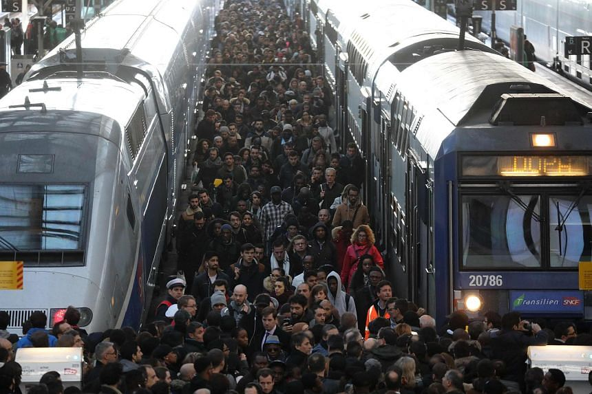 Commuters stand on a crowded platform of the Gare de Lyon railway station in Paris, on the first day of a two-day strike on April 3, 2018.