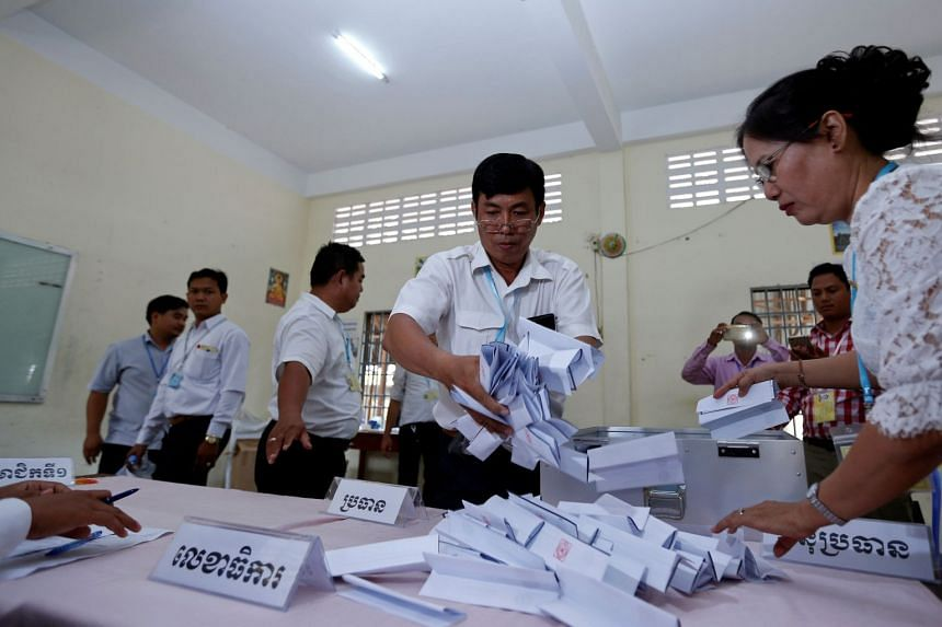 Members of the National Election Committee count ballots during a senate election in Phnom Penh, Cambodia on Feb 25, 2018.