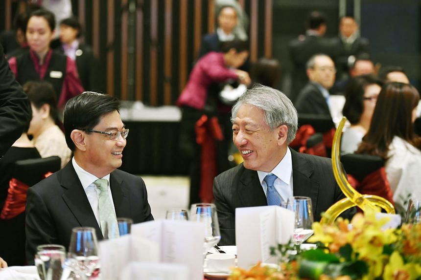 Finance Minister Heng Swee Keat and Deputy Prime Minister Teo Chee Hean, who is also the minister in charge of the civil service, at the annual Administrative Service dinner and promotion ceremony yesterday. Mr Heng had been invited to speak at the e