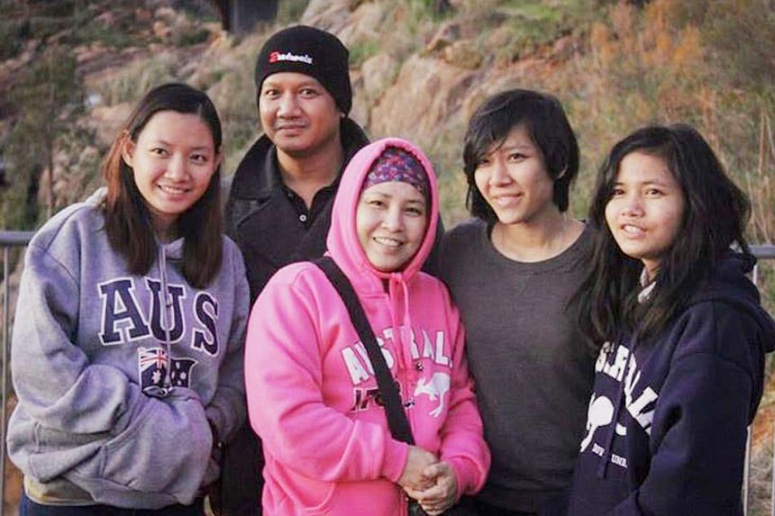 Singaporean Mirkhan Ariffin with his wife Nadine Sulastri (in pink) and their daughters (from left) Shazwani, 24, Sri Lyana, 22, and Sorfinah, 19. The girls are now in Indonesia with their father.