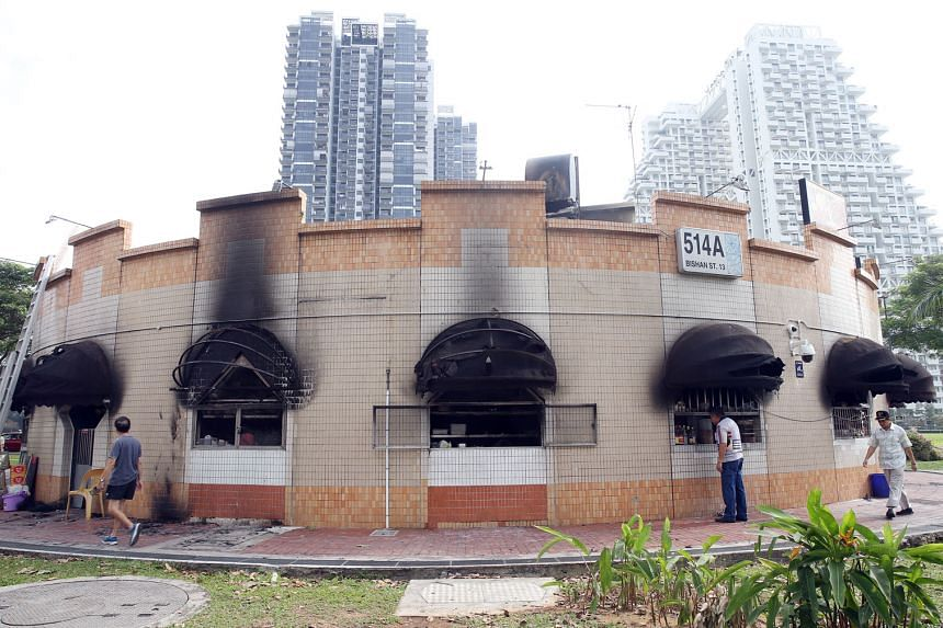 Two men were hurt when fire broke out at a coffee shop next to the Bishan bus interchange on Monday night. Yesterday morning, all the stalls in the coffee shop were closed. The building itself appeared intact although black soot covered parts of an e