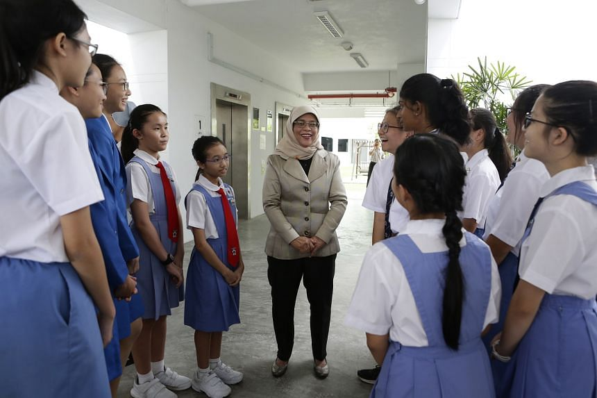 President Halimah Yacob speaking to students from Canossa Convent Primary School, St Anthony's Canossian Primary School and St Anthony's Canossian Secondary School on April 4, 2018.