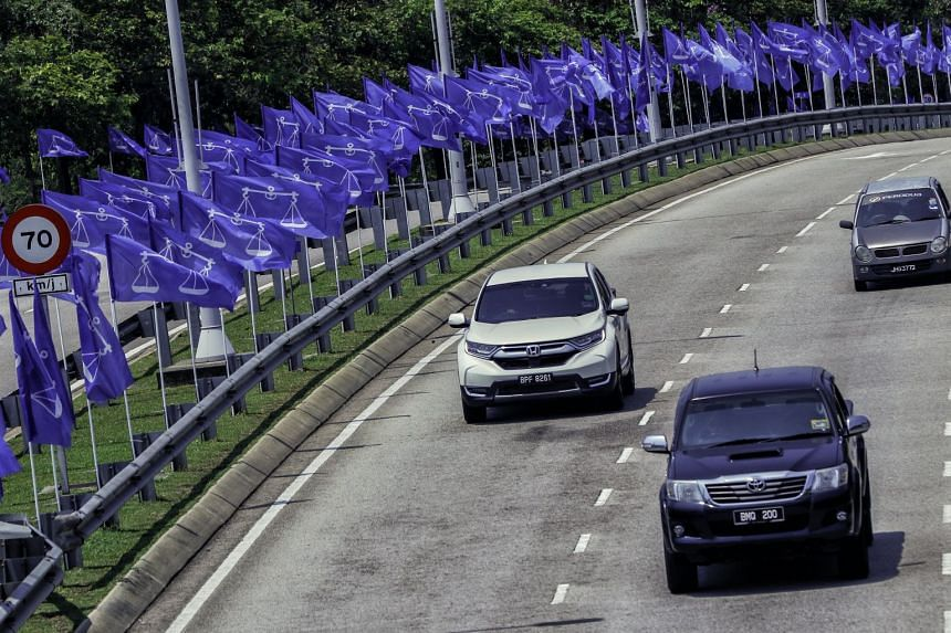 Flags of the Barisan Nasional, the ruling coalition, are installed along the highway in Putrajaya, Malaysia, on April 4, 2018.