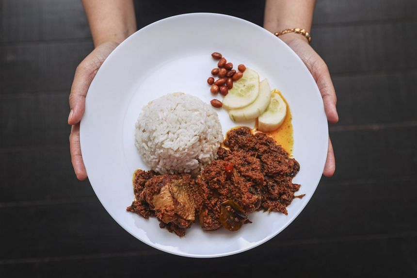 Rendang is traditionally made with chicken or beef that is slow cooked with Asian herbs and coconut milk.