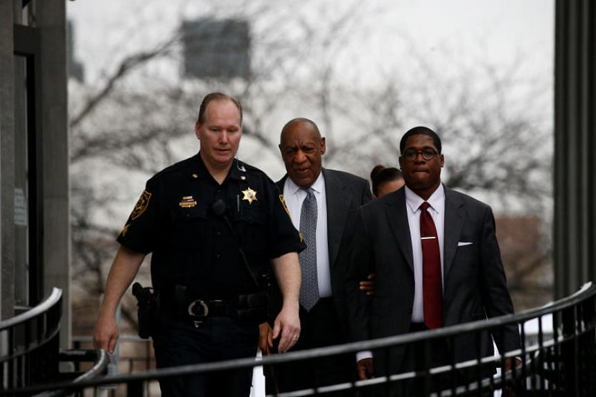 Actor and comedian Bill Cosby exits, with his publicist Andrew Wyatt, following jury selection for his sexual assault trial at the Montgomery County Courthouse in Norristown, Pennsylvania, on April 3, 2018.