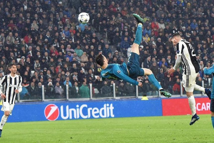 Real Madrid's Cristiano Ronaldo scores the 2-0 goal during the UEFA Champions League quarter final first leg soccer match between Juventus FC and Real Madrid CF at Allianz stadium in Turin, Italy, on April 3, 2018.