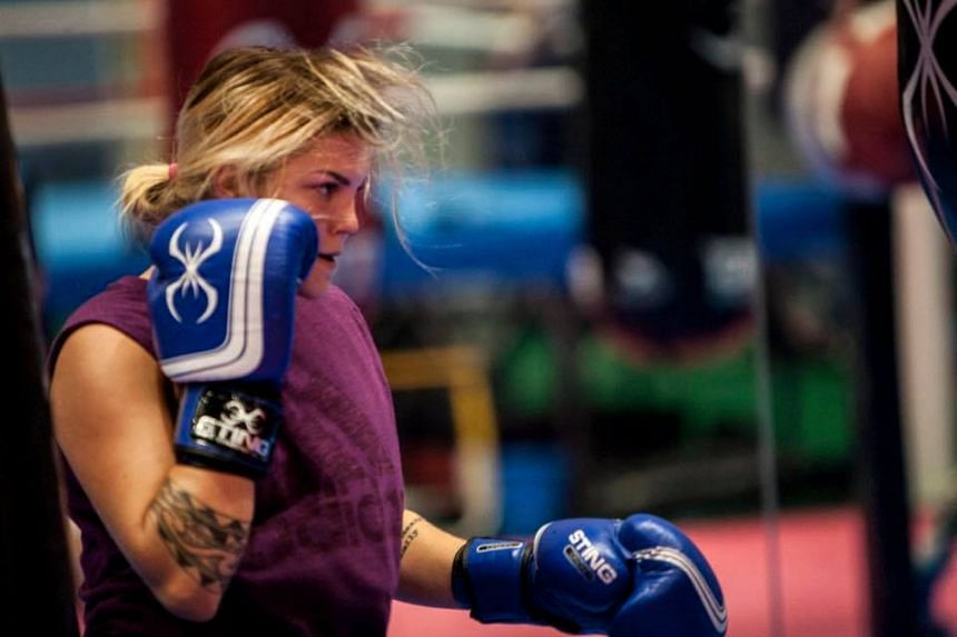 Australian boxer Taylah Robertson is guaranteed at least a bronze in the women's 51kg division after receiving a free pass to the semi-finals.