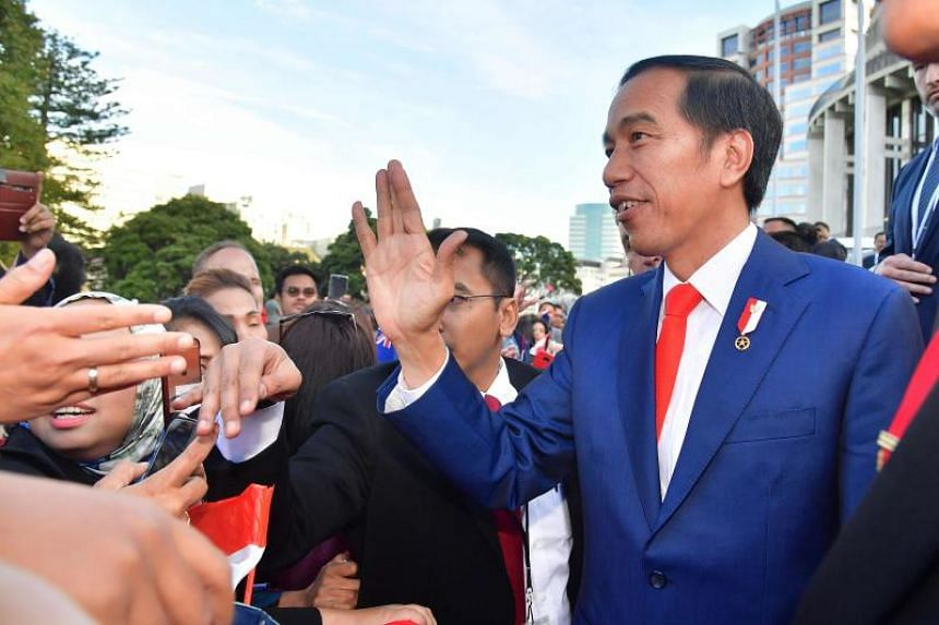 Indonesia's President Joko Widodo being greeted by supporters as he leaves the New Zealand Parliament in Wellington on March 19, 2018.