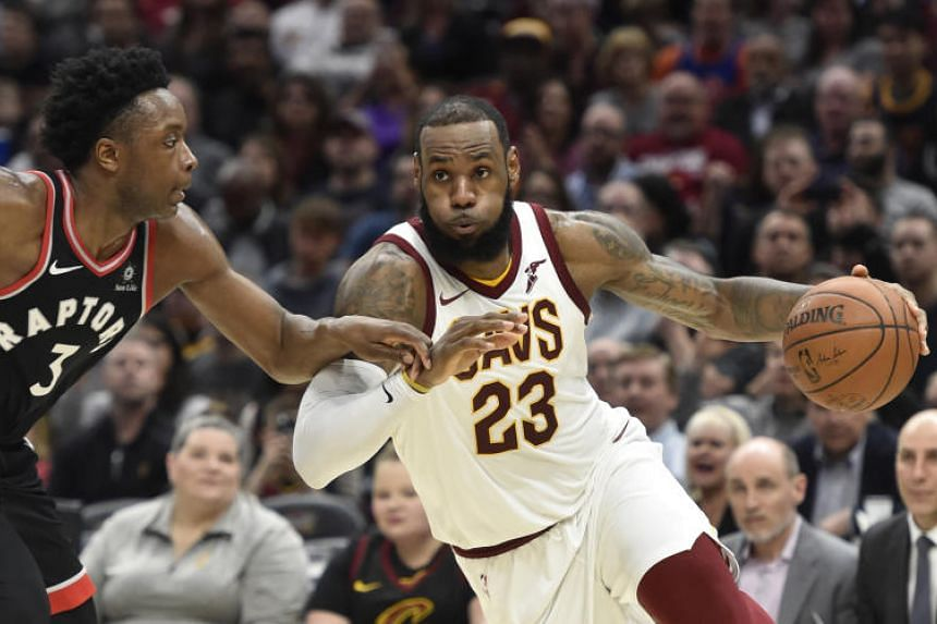 Cleveland Cavaliers forward LeBron James (right) drives against Toronto Raptors forward OG Anunoby in the third quarter at Quicken Loans Arena.