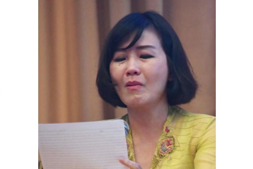 Veronica Tan breaking down as she reads a handwritten letter from her husband,  former Jakarta Governor Basuki Tjahaja Purnama, during a press conference in Jakarta on May 23, 2017.