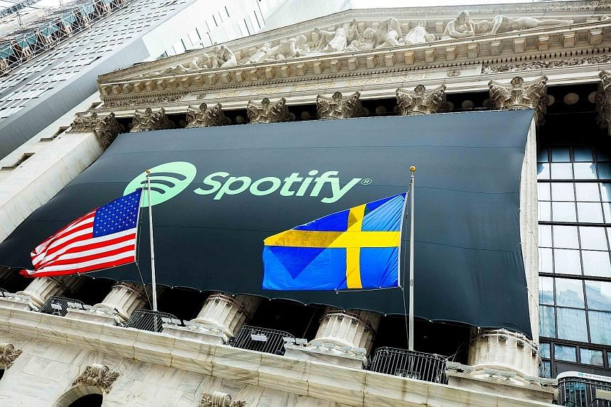 The Spotify logo on the facade of the NYSE, with the American and Swedish flags, on the stock debut of the firm founded by Swedish entrepreneurs Daniel Ek (above) and Martin Lorentzon.