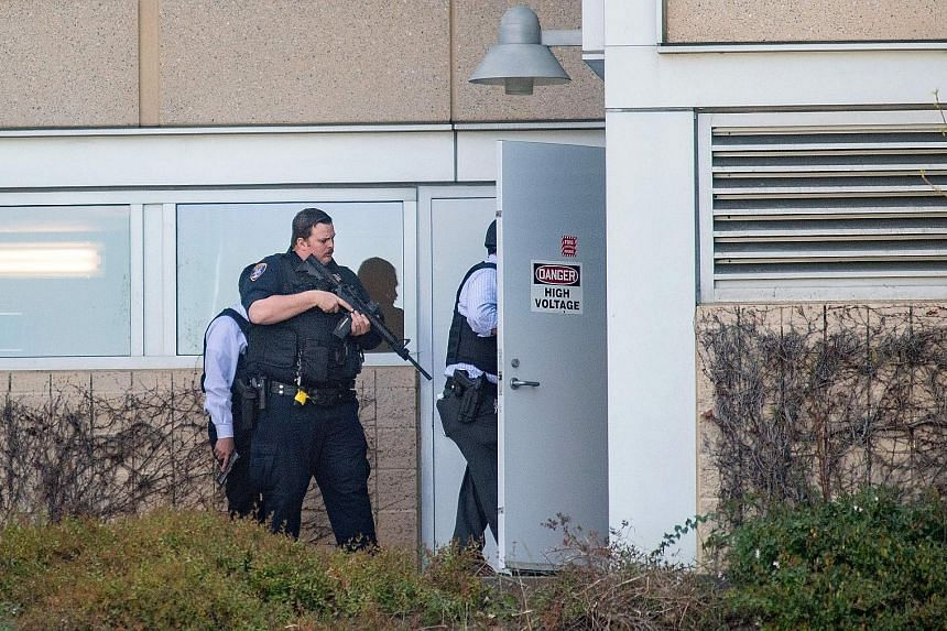 Employees leaving the building after the shooting at YouTube's headquarters in San Bruno, California, on Tuesday. A man was in critical condition and two women were seriously wounded in the attack. The alleged shooter, 39-year-old Nasim Najafi Aghdam