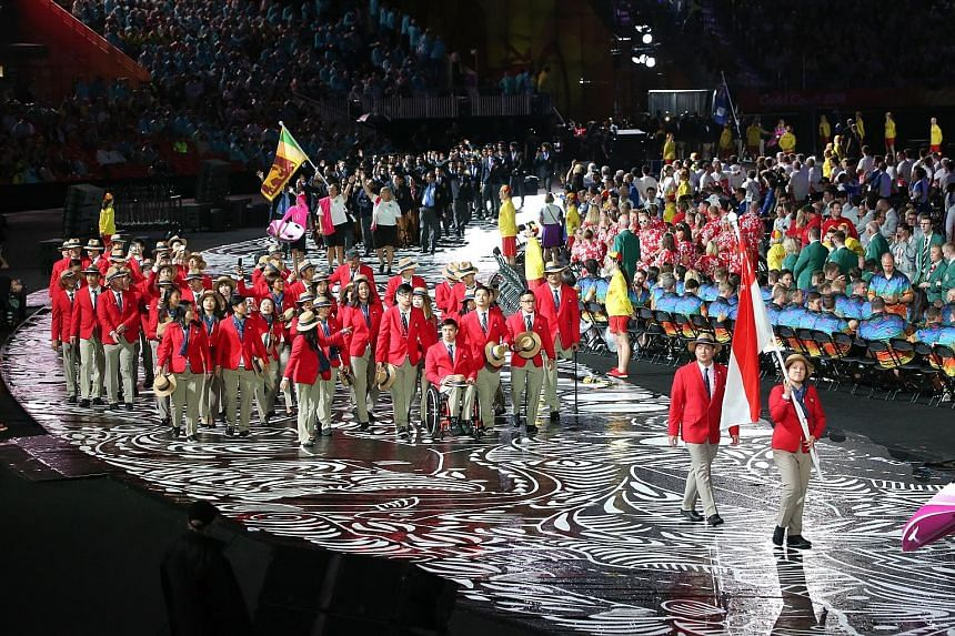 Flag-bearer and reigning Commonwealth Games 10m air pistol champion Teo Shun Xie leading the Singapore contingent during the opening ceremony in Carrara Stadium on Australia's Gold Coast yesterday. Singapore is represented in the Games by 60 athletes