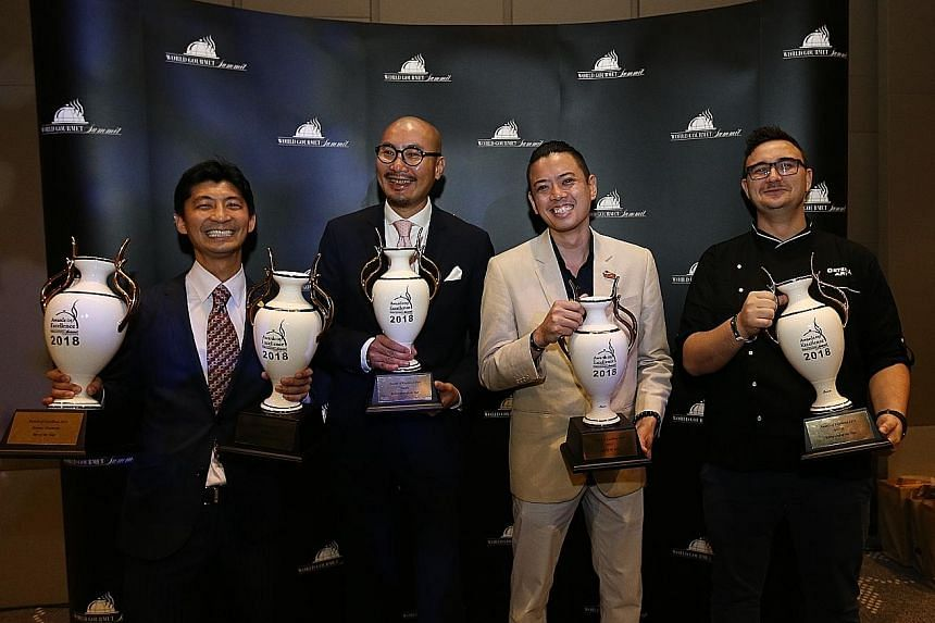 (From left) Mr Daisuke Kawai of La Terre, winner of Bar Manager of the Year, Old World Wine List of the Year and Bar of the Year; Mr Ricky Ng of Blue Lotus Concepts International is Restaurateur of the Year; Angus Chow of Boruto is Chef of the Year;