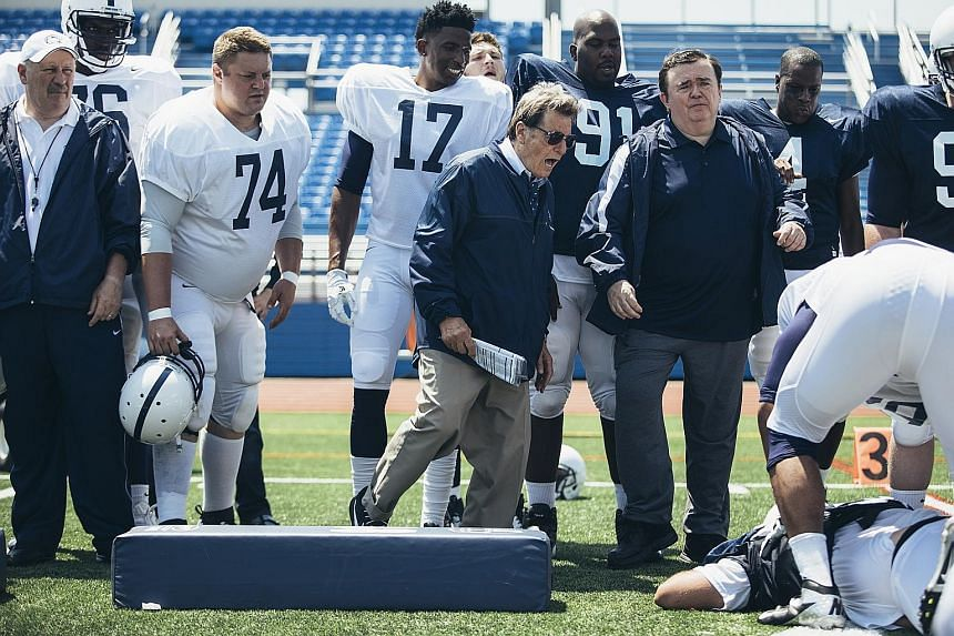 Al Pacino (wearing sunglasses) stars in Paterno as a college football coach who had known about child sex-abuse complaints against a colleague and had done nothing to stop it.