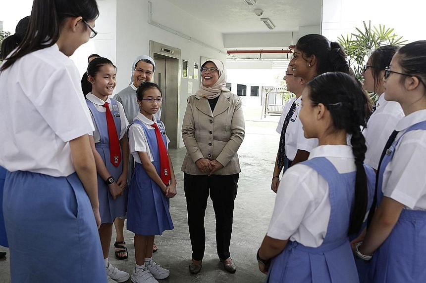 Students at the Canossian Girls' Leadership Symposium asked President Halimah Yacob questions on topics from her life as a student to her vision for Singapore's next 50 years