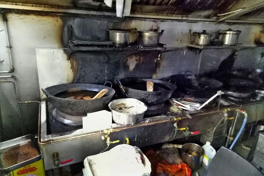 The charred remains of a kitchen at the coffee shop in Yishun where a fire broke out yesterday morning.