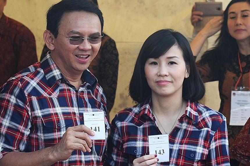 Ex-Jakarta governor Basuki Tjahaja Purnama with Ms Veronica Tan in February last year. The judge said she continued seeing Mr Julianto Tio (below) despite being told to stop.