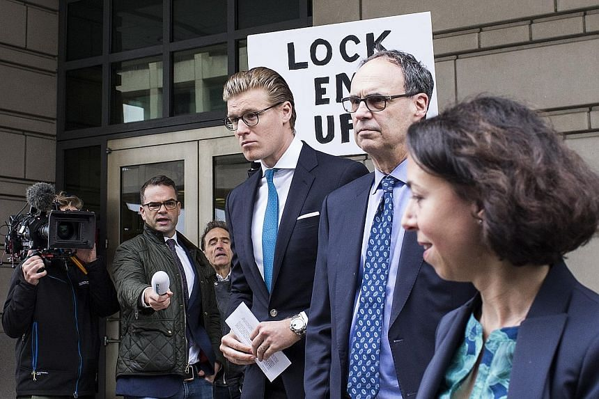 Alex van der Zwaan (third from right) exiting the Federal Court in Washington on Tuesday. He has been sentenced to 30 days in prison, two months of supervised release and fined.