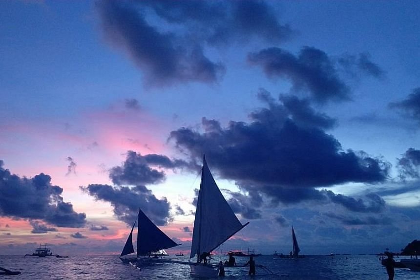 A view of the sunset along Boracay island coastline in the Philippines.