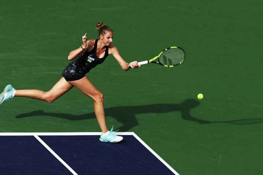 Kristyna Pliskova hits a forehand during her match against Simona Halep during the BNP Paribas Open at the Indian Wells Tennis Garden on March 9, 2018.