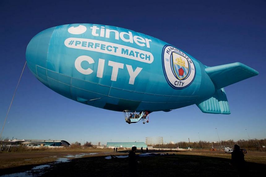 Tinder, the dating app owned by Match Group Inc, marked the beginning of the partnership by flying a blimp in City's club colours along with logos of both organisations in Manchester.