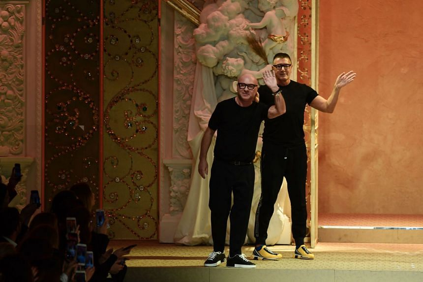 Dolce and Gabbana appear at the end of their women's Fall/Winter 2018/2019 show in February 2018.