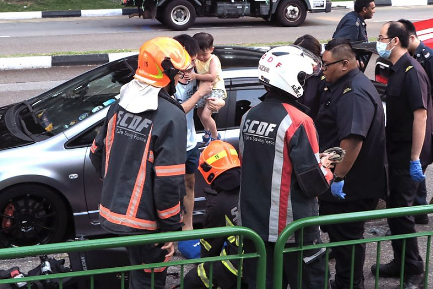Singapore Civil Defence Force officers rescued the boy using a tool to pry open the doors of the car.