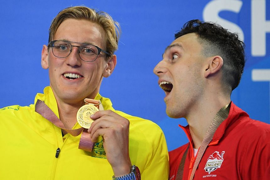 Australia's Mack Horton (left) poses with his gold medal beside England's James Guy after the men's 400m freestyle final during the 2018 Gold Coast Commonwealth Games at the Optus Aquatic Centre on April 5, 2018.