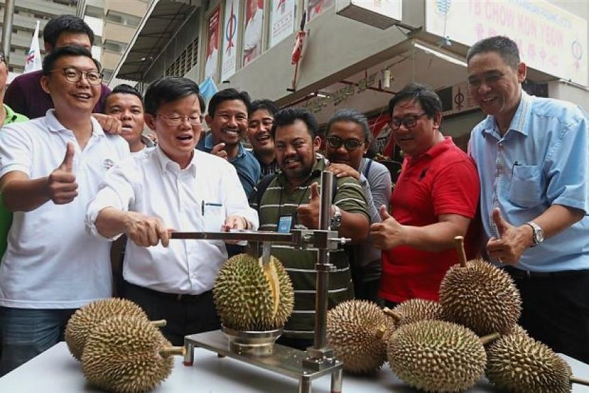 State DAP chairman Chow Kon Yeow hosting a durian party with media members at his service centre at Jalan Kedah in George Town, Malaysia.