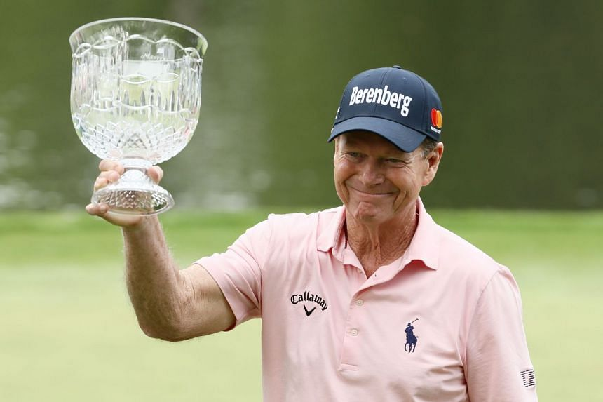 Tom Watson celebrates with the trophy after winning the Par 3 Contest prior to the start of the 2018 Masters Tournament at Augusta National Golf Club on April 4, 2018.