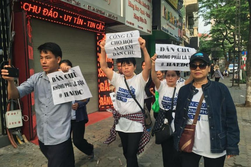 Protesters marching towards a courthouse during the trial of a prominent lawyer and five other activists in Hanoi on April 5, 2018.