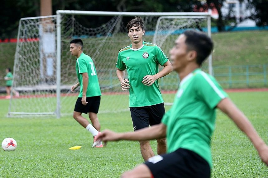 Geylang skipper Anders Aplin (centre) training during pre-season with his Eagles team-mates. The Singapore defender is backing his team to follow their promising start to the season with a positive performance against Tampines.