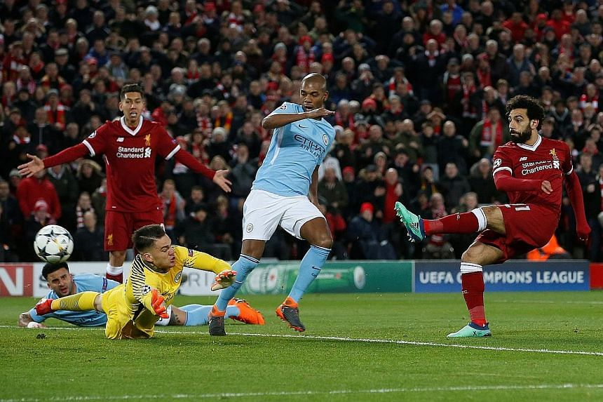 From top: Mohamed Salah rifling home Liverpool's first goal past the reach of Manchester City goalkeeper Ederson. The Egyptian was a scourge to City, but had to be withdrawn in the second half owing to a groin injury. Before the game, Liverpool fans
