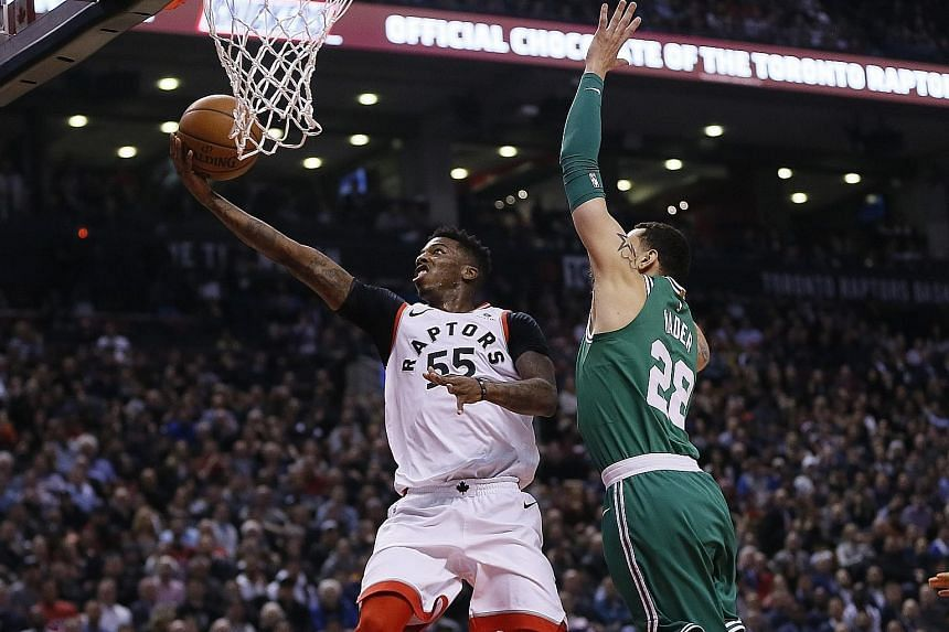 Toronto Raptors guard Delon Wright driving to the basket as Boston Celtics forward Abdel Nader tries to defend. The NBA game ended 96-78 in favour of the Raptors, while the Celtics recorded their season low in points and fell to their second straight