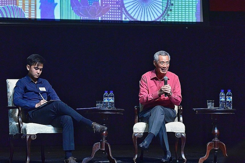 """Singapore can become a multi-layered city like the great cities of the world - """"always changing, always fresh"""", said Prime Minister Lee Hsien Loong, seen here with moderator Charles Wong at the inaugural Ministerial Forum of the Singapore University"""