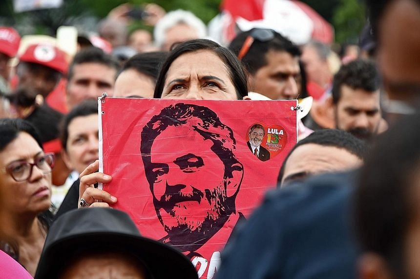 Supporters of former president Luiz Inacio Lula da Silva gather as the court deliberates on whether the front-runner for October's election should start a 12 year prison sentence for corruption. Its decision is a serious blow to the political surviva