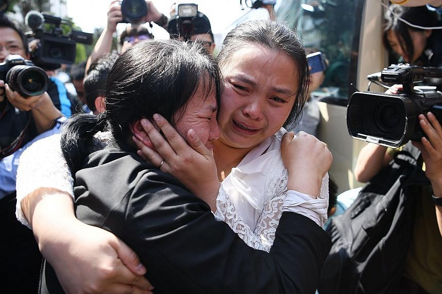 Ms Kang Ying (right) and her mother Liu Dengying embracing after being reunited on Tuesday after 24 years, in Chengdu in China's south-western Sichuan province.