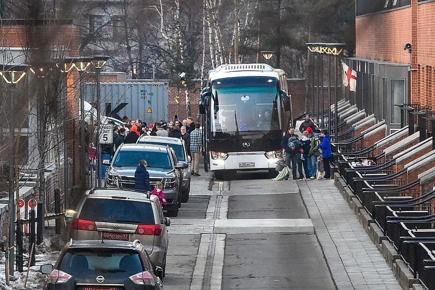 US diplomats and their families who have been expelled from Russia prepare to board a bus to leave the American Embassy compound in Moscow yesterday. The nerve agent attack in England sparked mass expulsions and a decision by Britain and a few of its