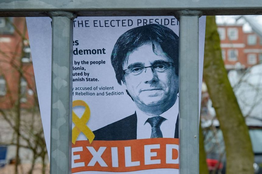 A portrait of Puigdemont attached to the fence of the German prison where he is being held.