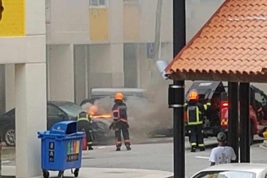 Firefighters work to put out the fire.