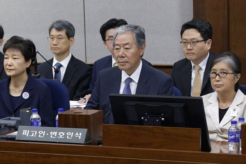 Former South Korean President Park Geun Hye (left) sits near her longtime friend Choi Soon Sil (right) for her trial at the Seoul Central District Court on May 23, 2017.