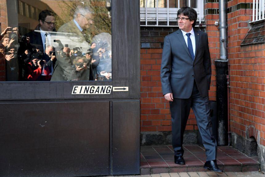 Former Catalan President Carles Puigdemont leaves a prison in Neumuenster, Germany, on April 6, 2018.