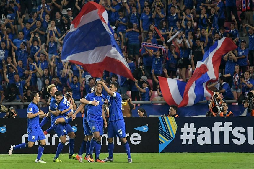 A file photo of Thai players celebrating during their Asean Football Federation (AFF) Suzuki Cup 2016 final match against Indonesia, on Dec 17, 2016.