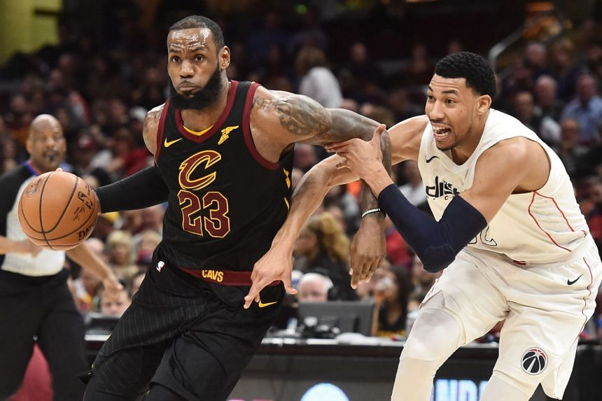 Cleveland Cavaliers forward LeBron James drives to the basket against Washington Wizards forward Otto Porter Jr. during the second half of the match at Quicken Loans Arena on April 5, 2018.