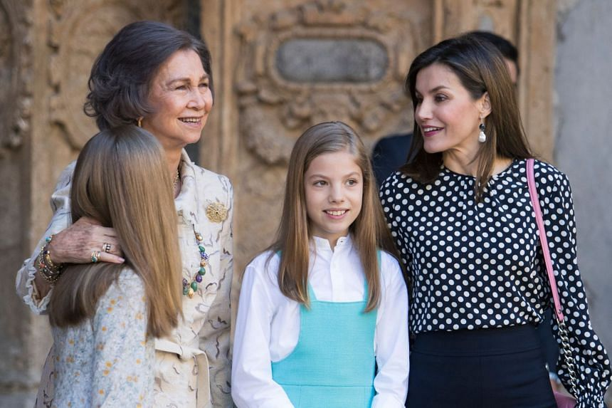 Queen Letizia of Spain (right) stands with her daughters Princess Sofia (front right) and Leonor (front left) and former Queen Sofia (left) after attending the traditional Easter Sunday Mass of Resurrection in Palma de Mallorca on April 1, 2018.