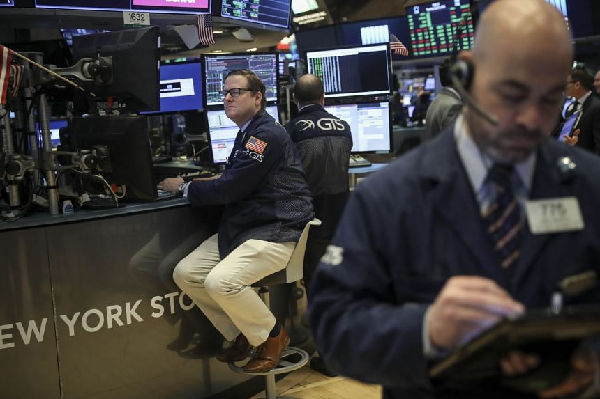 Traders and financial professionals work at the opening bell on the floor of the New York Stock Exchange on April 5, 2018.