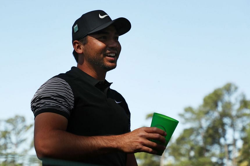 Jason Day talks with a patron after his shot landed in the patron's beverage.